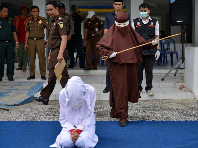 Indonesia's first female flogger prepares to whip a woman in public