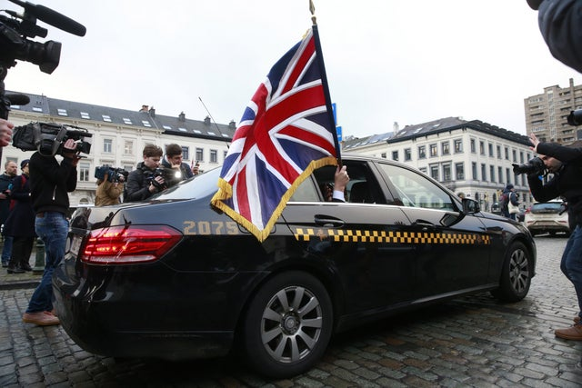 Jonathan Bullock waves the Union Jack as he leaves the European Parliament