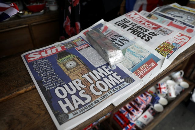 Newspapers and other souvenirs at a store, near Parliament Square