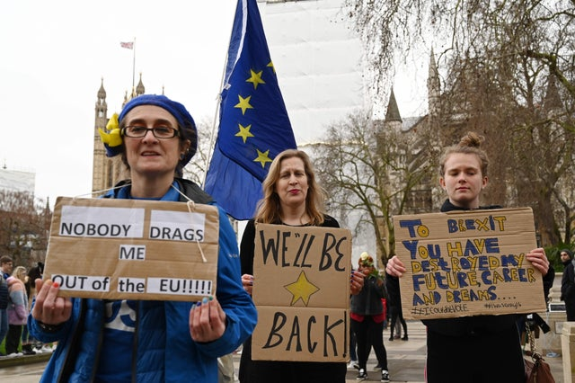 Pro-EU protesters hold placards in Parliament Square