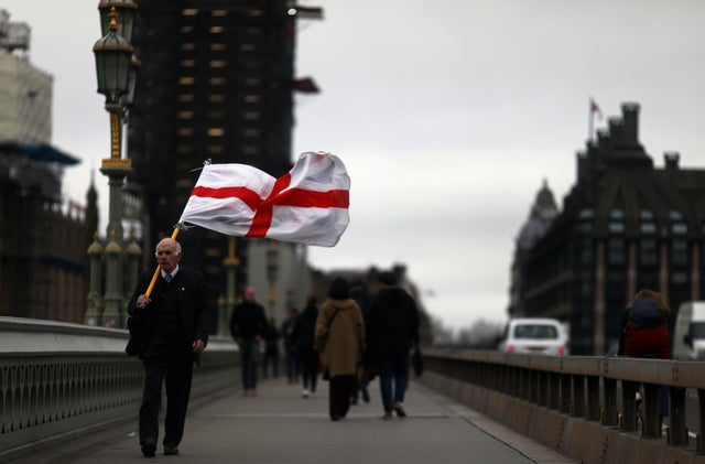 A man walks with a St. George's flag at Westminster bridge on Brexit day