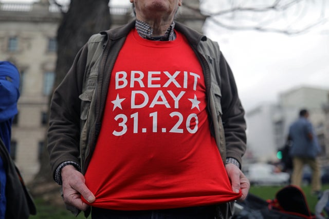 A man poses for a picture on Parliament Square in a 'Brexit Day' t-shirt