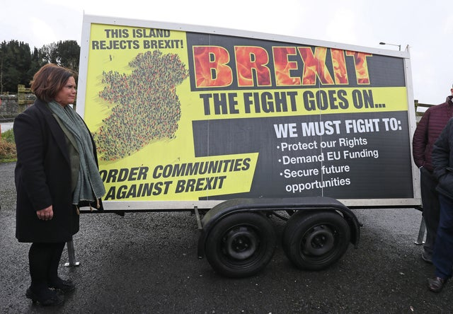 Sinn Fein leader Mary Lou McDonald with a Border Communities Against Brexit poster before its unveiling in Carrickcarnon on the Irish border