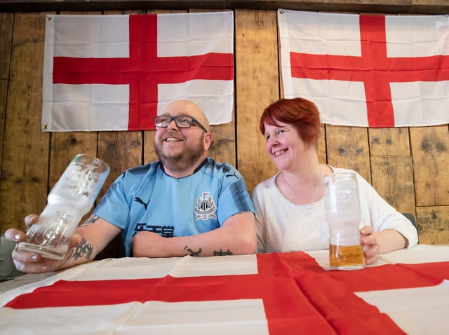 Customers Scott Jones and Laura Jones at the Sawmill Bar in South Elmsall, Yorkshire, where a Brexit party is being held throughout the day