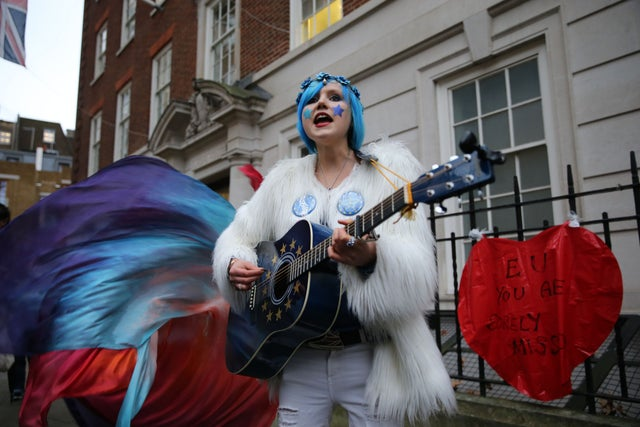 A pro-EU activist plays a guitar decorated with the EU flag during a protest organised by civil rights group New Europeans outside Europe House, central London