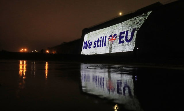 A large pro-EU banner is projected onto Ramsgate cliff in Kent