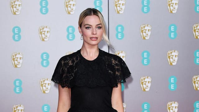 <I>Birds of Prey</I> star Margot Robbie opted for a black floor-length Chanel gown for the Baftas on Sunday night. The dress featured delicate lace sleeves and a matching peplum at the waist. The star accessorised the look with a simple pair of hoop earrings and a black flower ring.