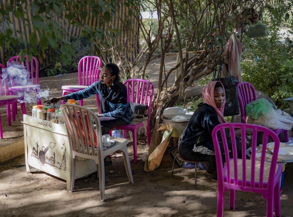 Sellers set up their stalls in Khartoum, Sudan