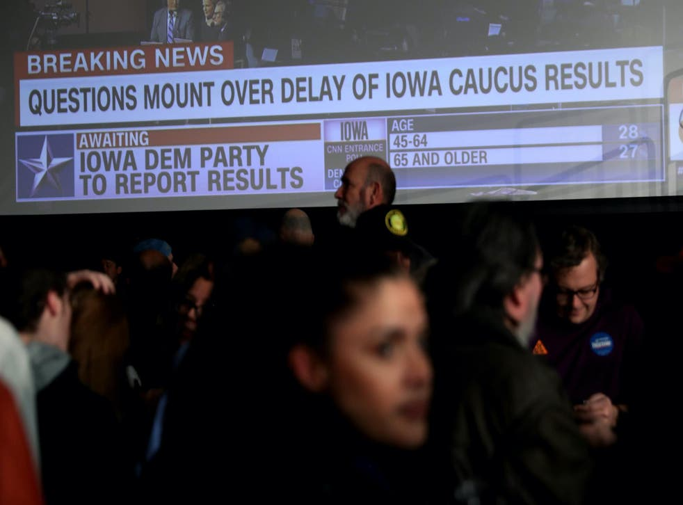 Supporters of democratic presidential candidate Sen. Bernie Sanders (I-VT) wait for results to come in at his caucus night watch party on February 03, 2020 in Des Moines, Iowa