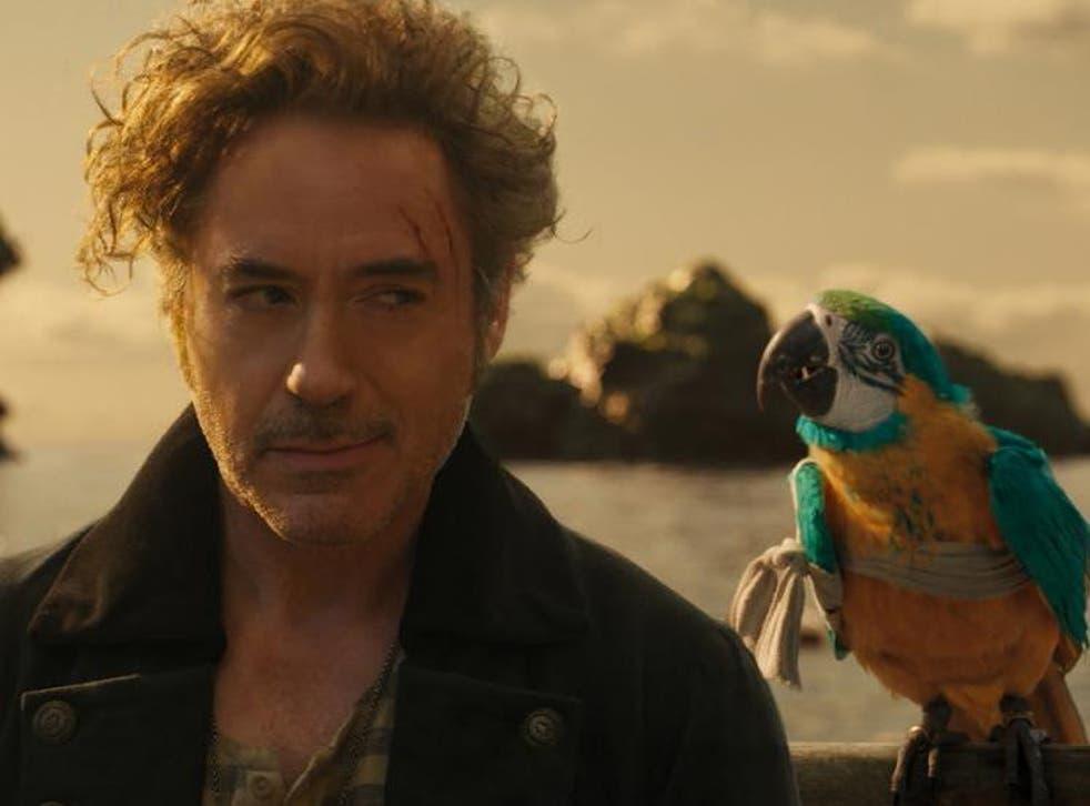 Robert Downey Jr as Dr John Dolittle alongside a talking parrot voiced by Emma Thompson