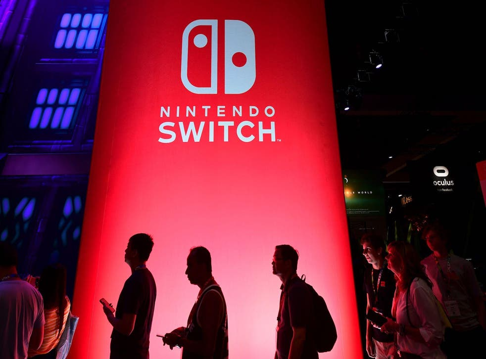 People wait in line for a chance to sample new games for Nintendo Switch at the 2019 Electronic Entertainment Expo, also known as E3, opening in Los Angeles, California on June 11, 2019