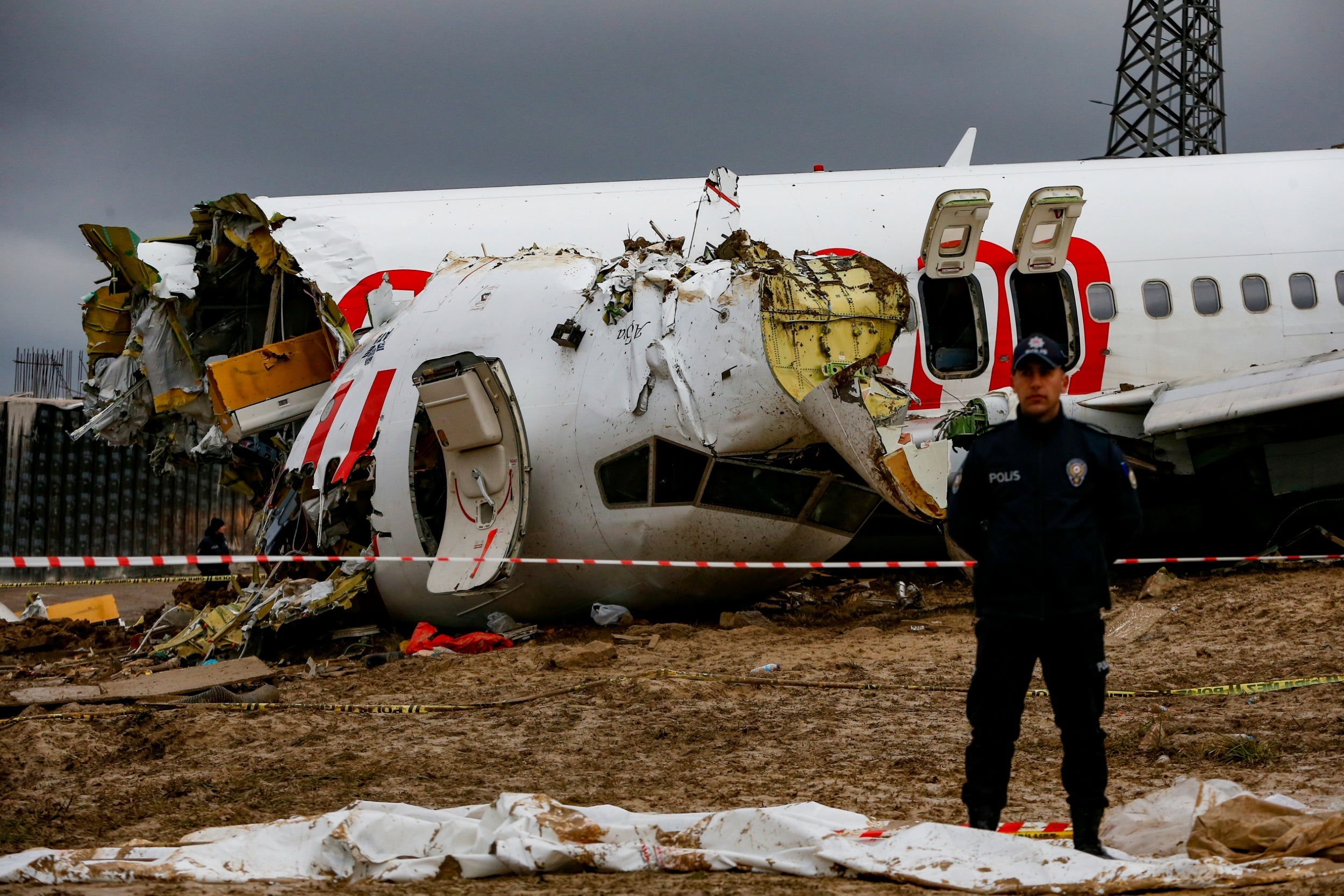 Pilot arrested after plane skids off runway, killing three people
