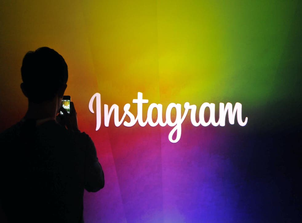 An Instagram employee takes a video using Instagram's new video function at Facebook's corporate headquarters during a media event in Menlo Park, California on June 20, 2013