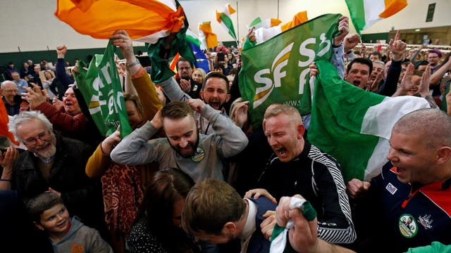Sinn Fein candidate Donnchadh O'Laoghaire celebrates with supporters