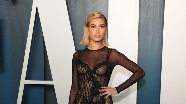 Supermodel Hailey Bieber attended the afterparty wearing a sheer black dress designed by Versace that featured a lace undergarment and thigh-high split.