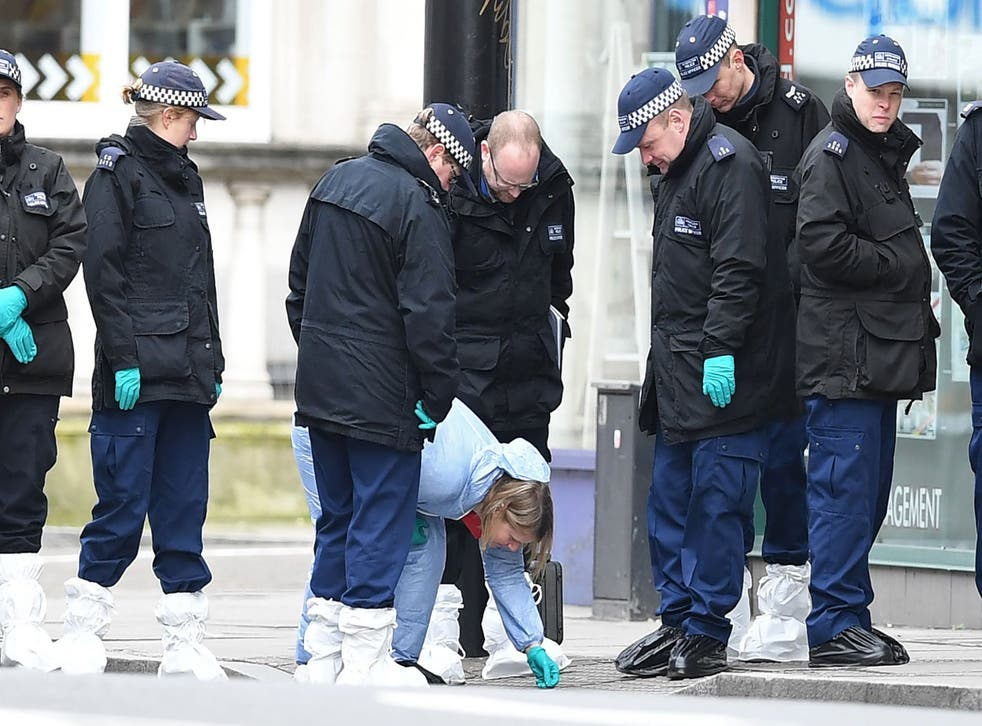 Police officers conduct a search in south London after the Streatham attack last month
