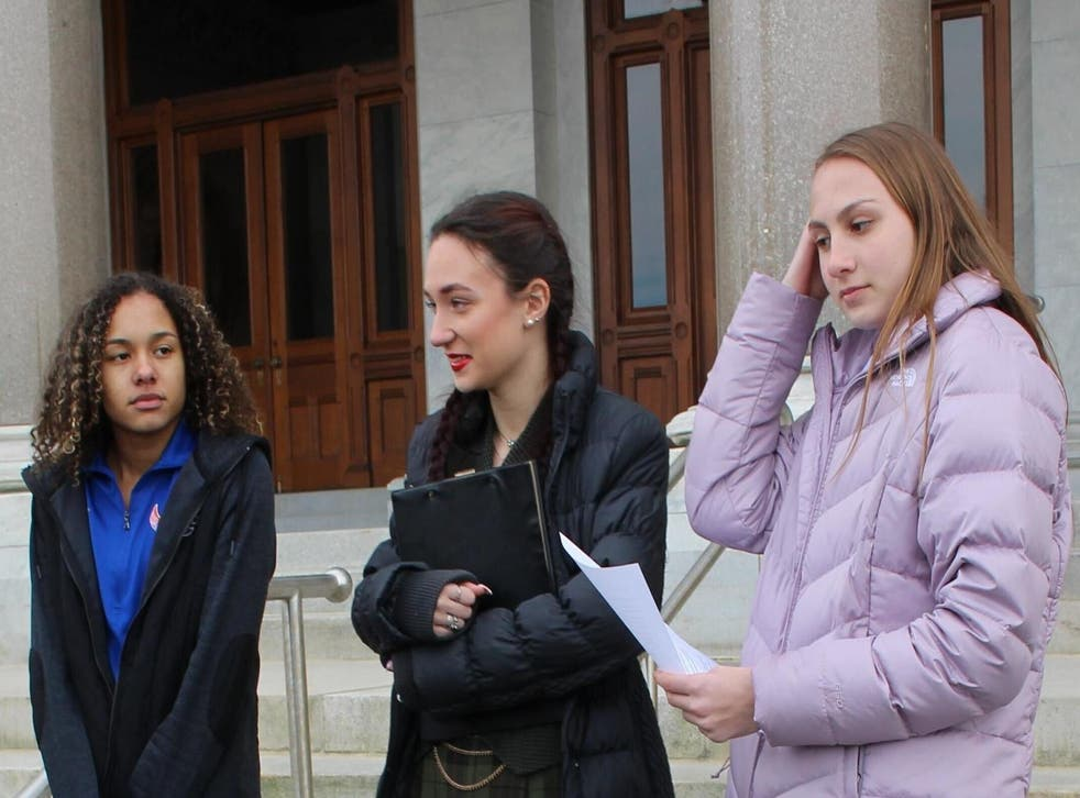 High school track athletes Alanna Smith, left, Selina Soule, centre and and Chelsea Mitchell prepare to speak at a news conference outside the Connecticut State Capitol in Hartford
