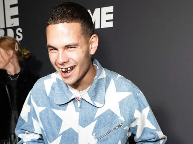Slowthai drinks from a can of beer on the NME Awards red carpet last night