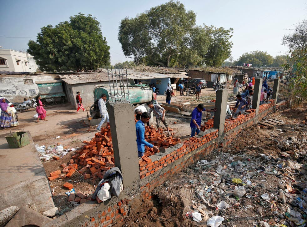 Constructors building the wall in Ahmedabad India 13 February