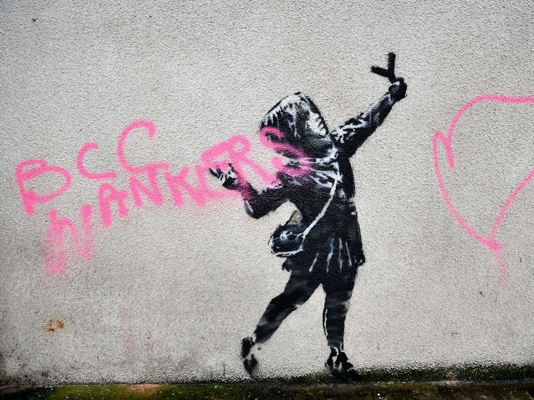 Banksy says he is 'glad' his latest work has been vandalised