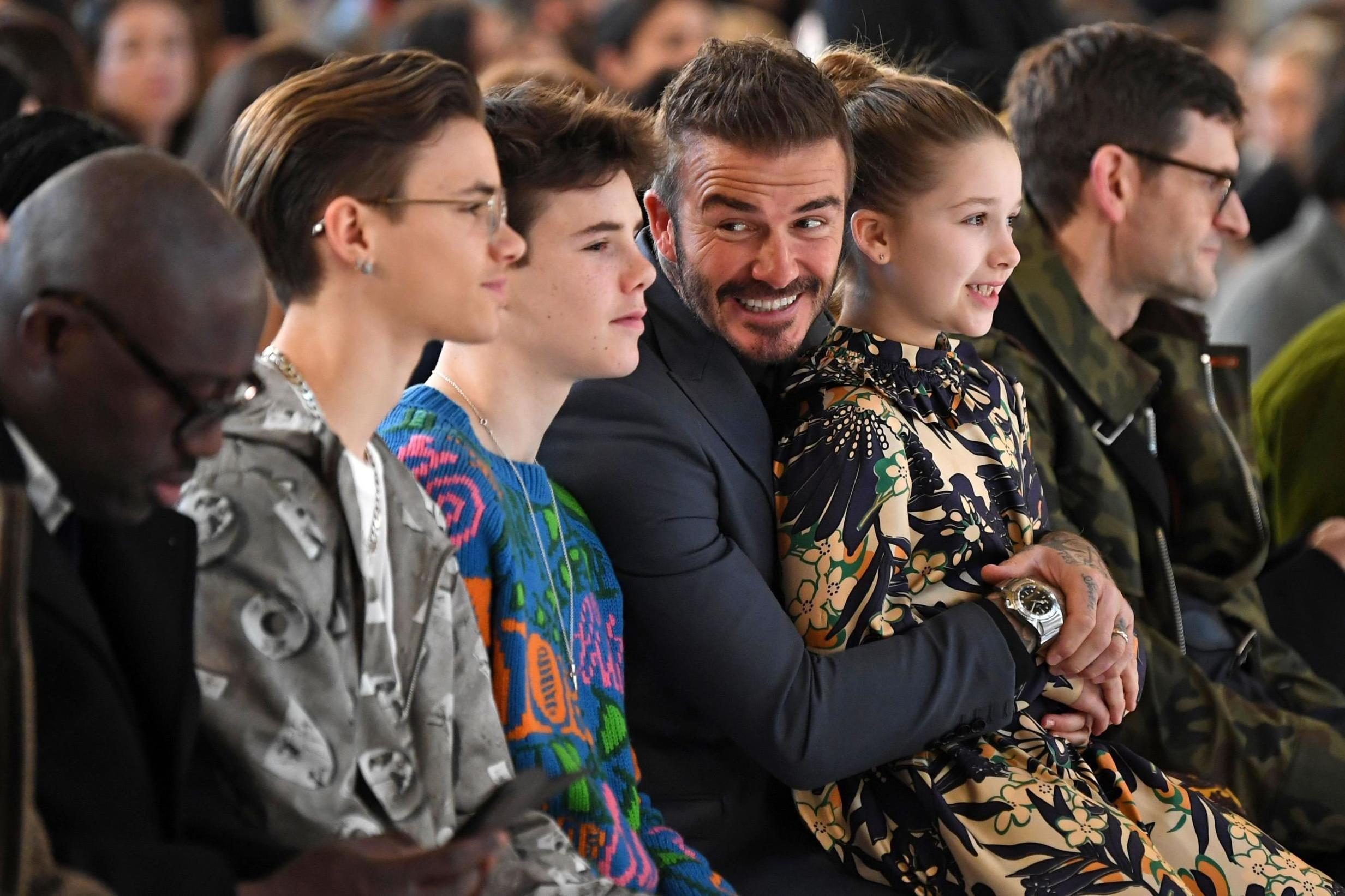 Victoria Beckham's family sit front row to watch London Fashion Week show