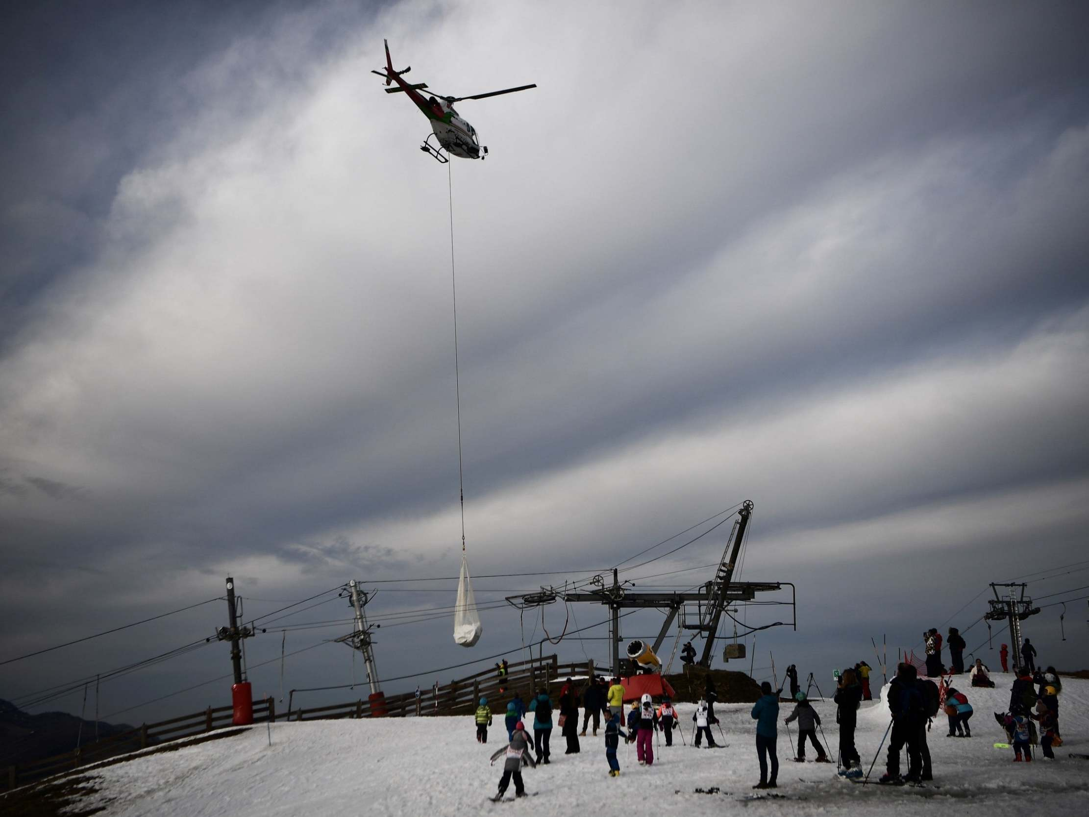 Outrage as French ski resort drops snow by helicopter after pistes melt