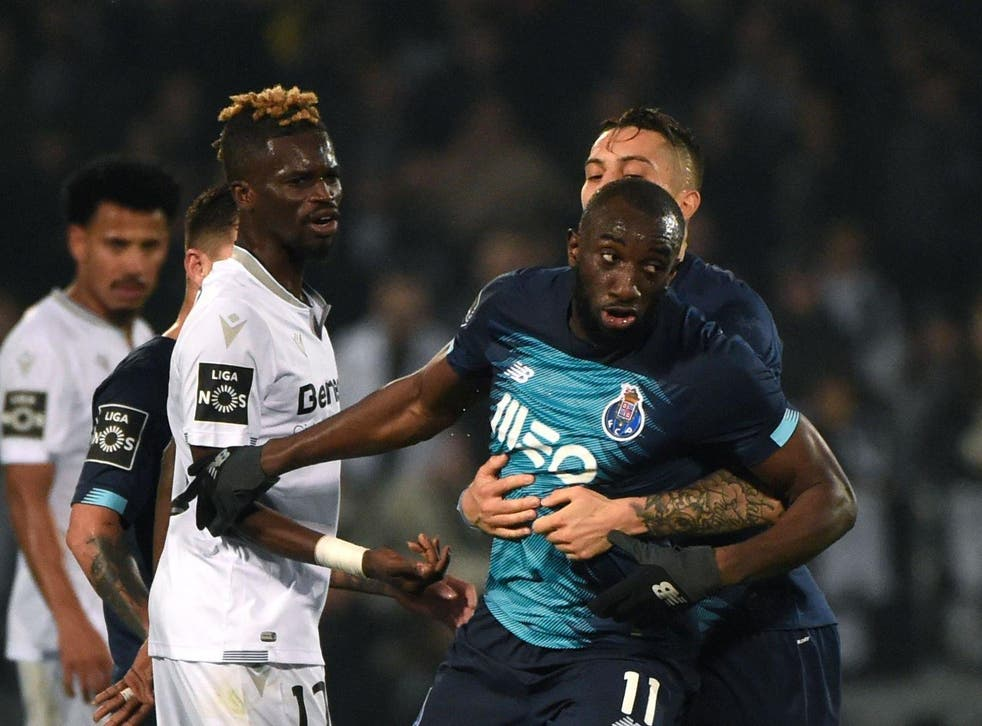 Players tried to stop Marega from leaving the pitch (AFP via Getty)