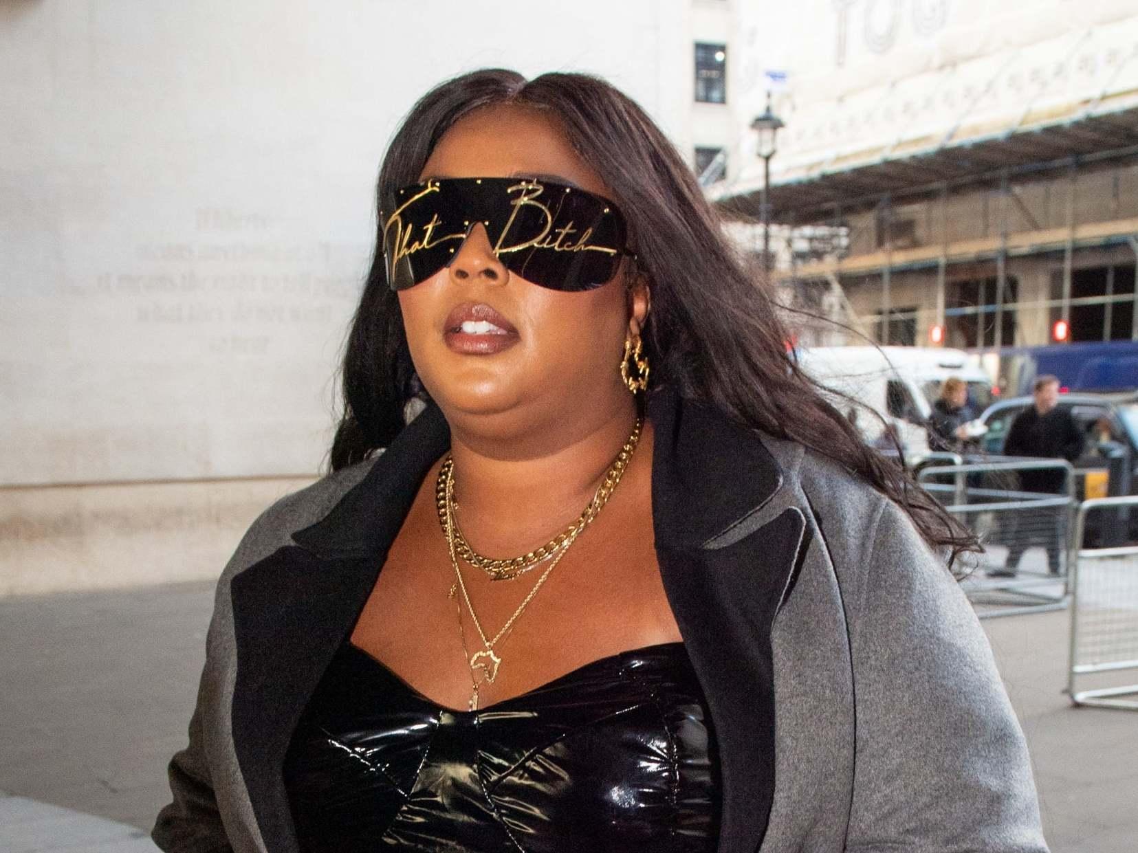 Lizzo wears 'That Bitch' sunglasses ahead of BBC Radio 1 Live Lounge performance