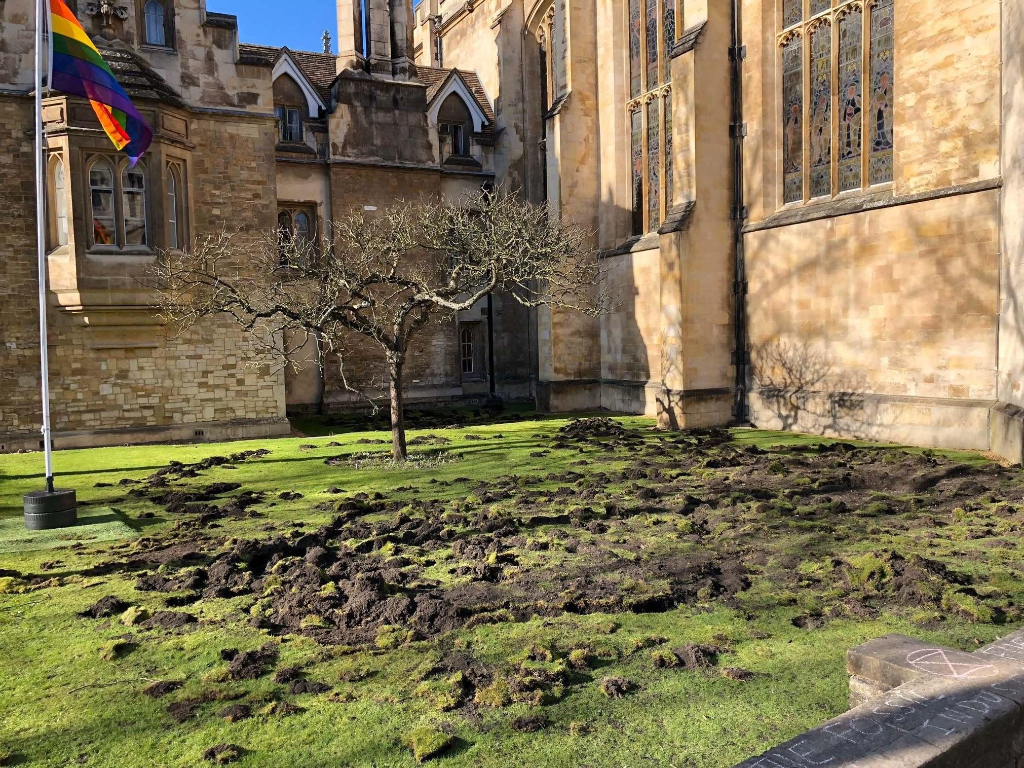 Extinction Rebellion dig up Cambridge University lawn