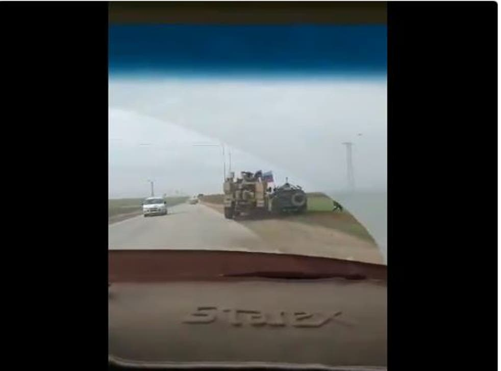 A US MRAP forces a Russian Tigr 4x4 off road in Syria after the Russian vehicle attempts to pass.