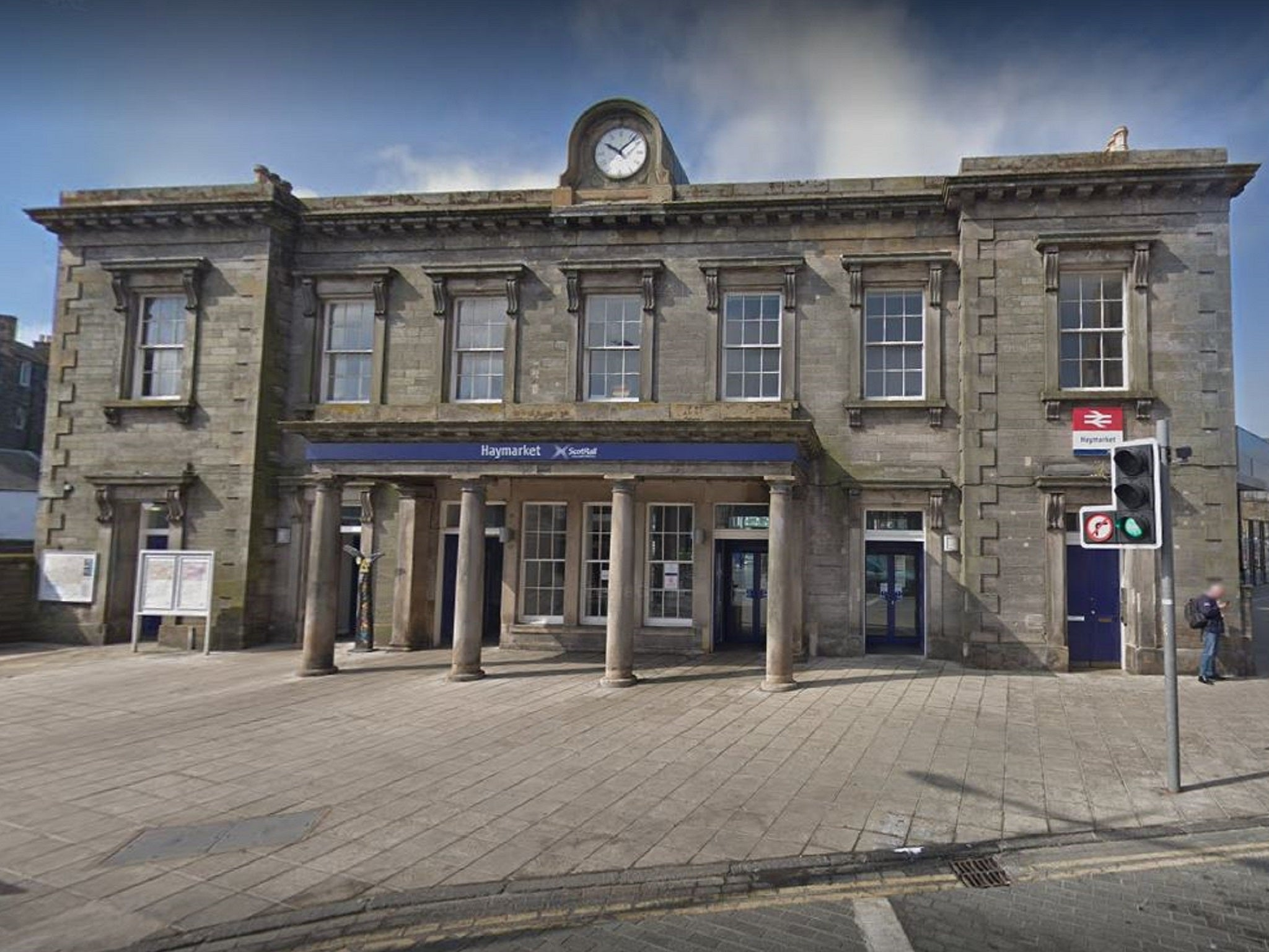 Man fighting for life after being pushed down stairs in train station