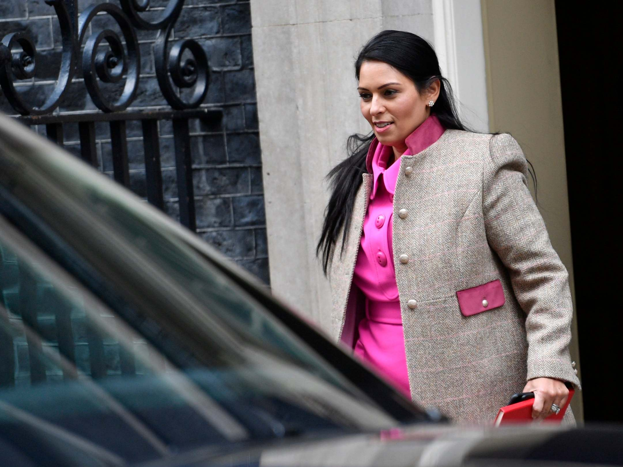 Priti Patel department facing 'tropical storms' amid calls for new bullying investigation, and claims Windrush report watered down - follow live