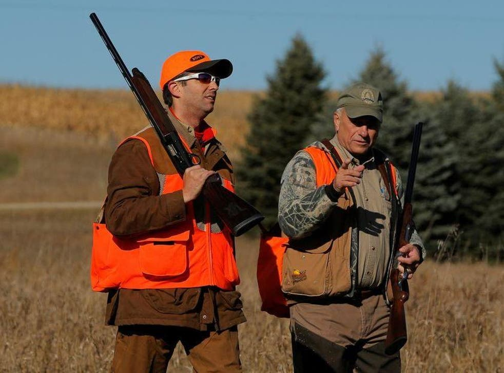Donald Trump Jr, left, walks with Rep Steve King, Republican for Iowa, after the Colonel Bud Day memorial pheasant hunt in 2017