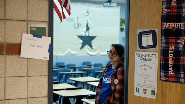 Jessica Canicosa, a precinct captain for Bernie Sanders, waits to greet caucus voters at Liberty High School in Henderson, Nevada
