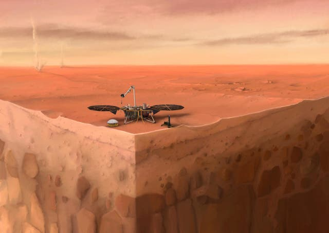 In this artist's concept of NASA's InSight lander on Mars, layers of the planet's subsurface can be seen below and dust devils can be seen in the background