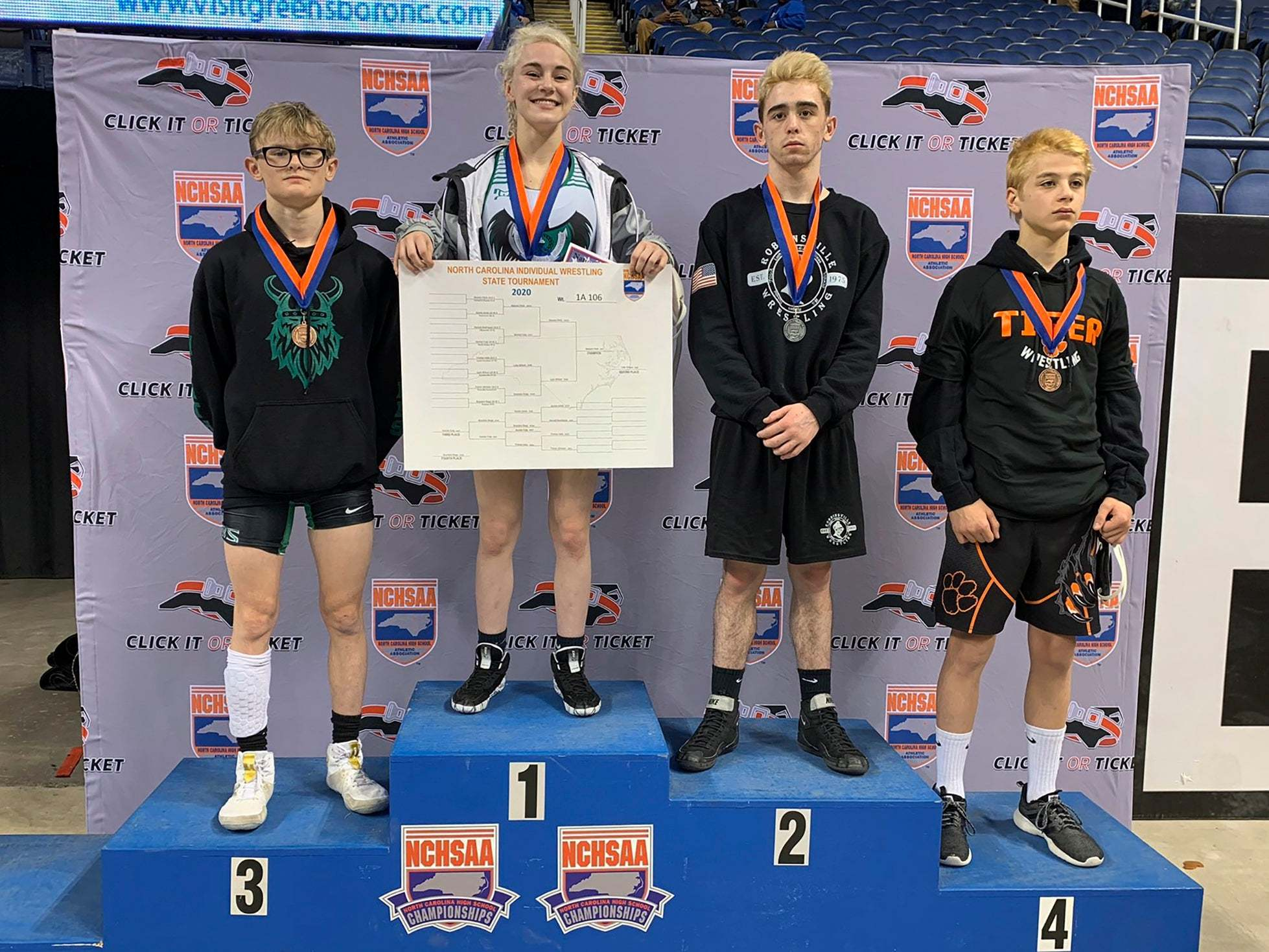 Teenage wrestler becomes first ever female to win individual state championship - independent