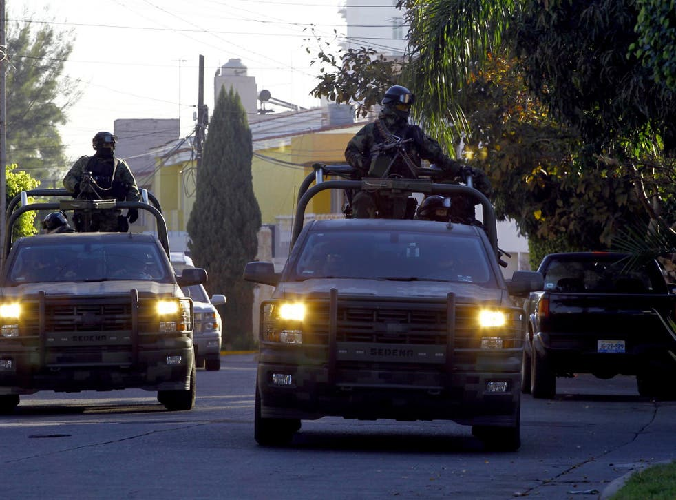 """Mexican soldiers patrol the Jardines Universidad zone during a military operation during which Ruben Oseguera Gonzalez, aka """"el Menchito"""" son of the leader of the Jalisco next Generation cartel, was then arrested, in Guadalajara, Mexico on 30 January 2014"""