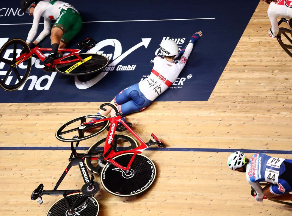 Great Britain's Laura Kenny crashes whilst riding the Women's Omnium Scratch Race