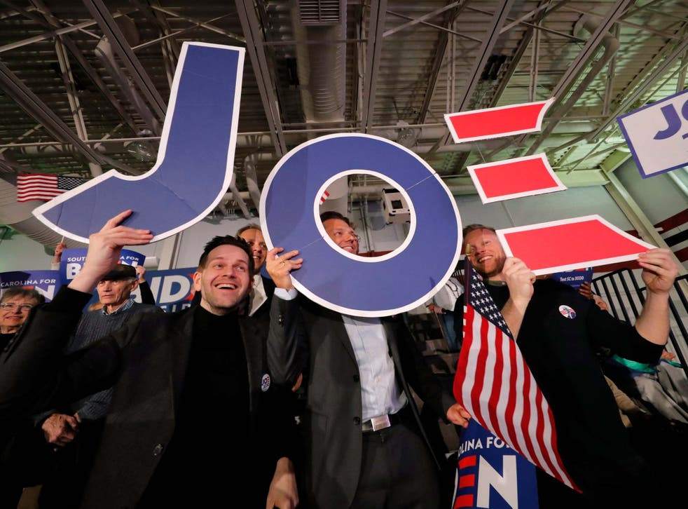 Supporters cheer at a primary election night rally for Democratic presidential candidate former vice president Joe Biden in South Carolina