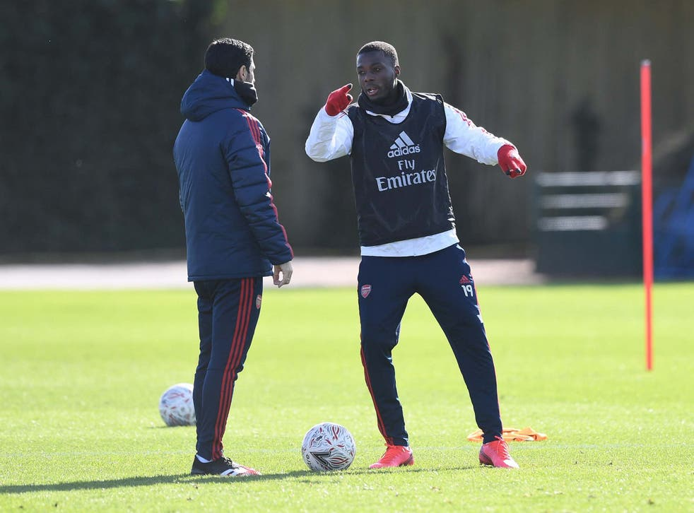 Mikel Arteta with Arsenal's record signing Nicolas Pepe in training