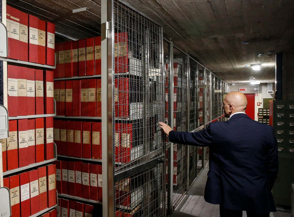 A man opens the archive section of the Holy See for the papacy of Pius XII, at the Vatican