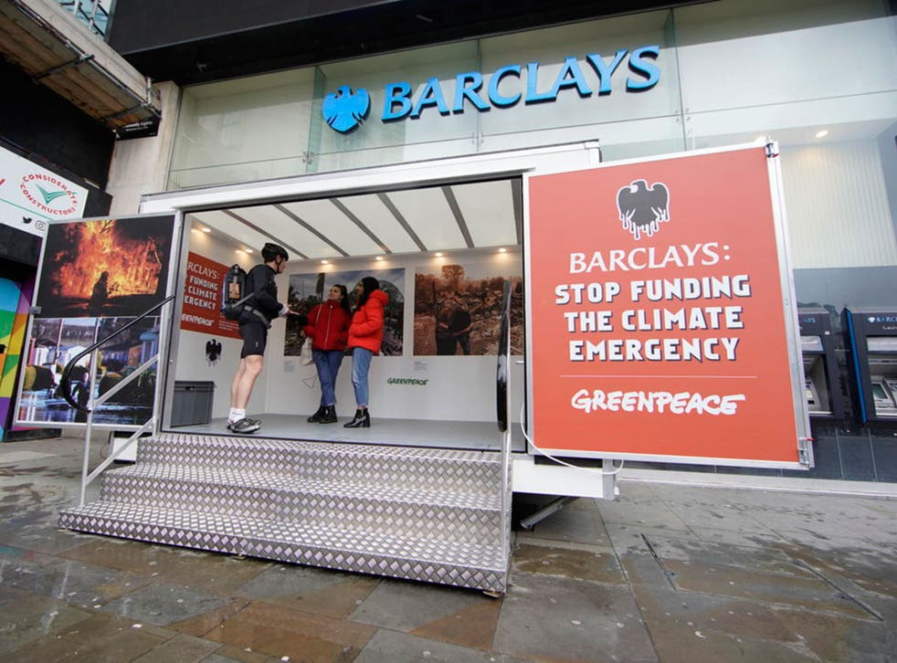 Protesters install pop-up exhibitions in front of the doors of branches