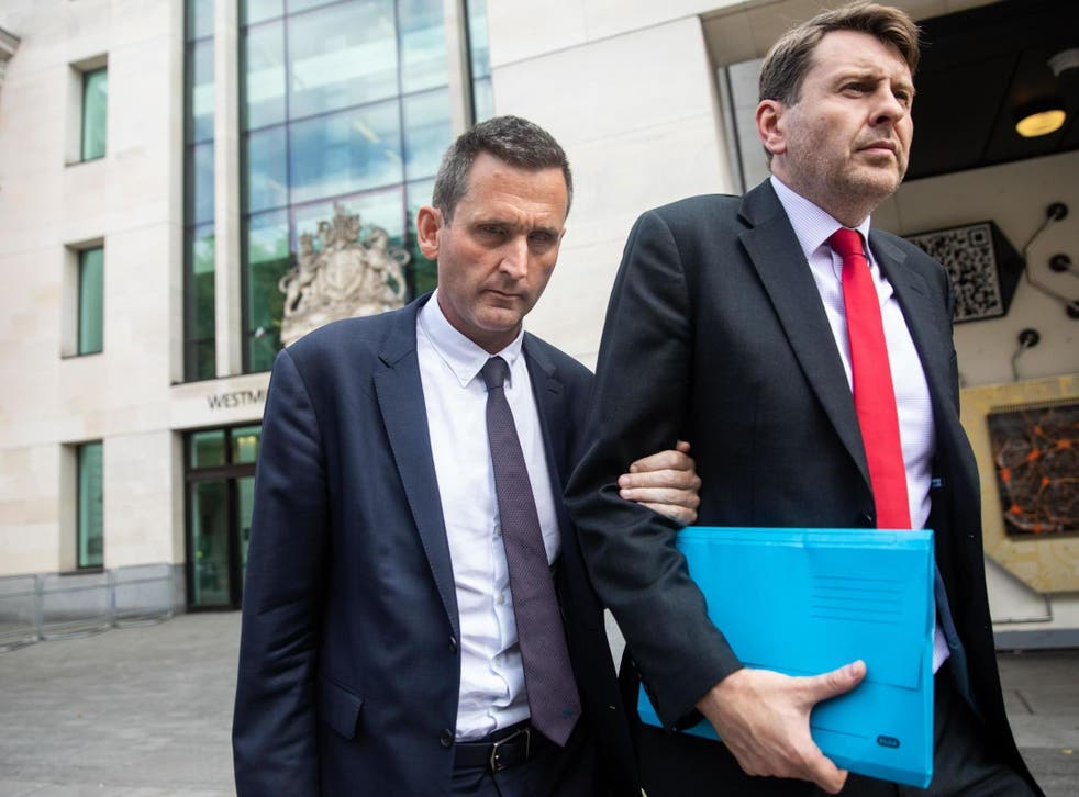 Baron Holmes of Richmond (left) leaves Westminster Magistrates' Court where he appeared on charges of sexual assault on 22 July 2019.