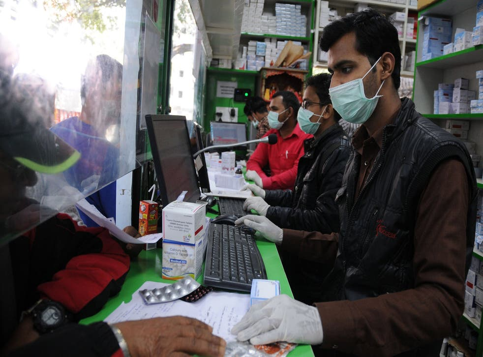 People wear protective masks as a precaution against coronavirus in Delhi on Thursday