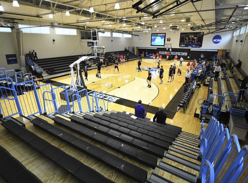 A mostly empty Goldfarb Gymnasium at Johns Hopkins University where Yeshiva University played against Worcester Polytechnic Institute in a game without spectators after cases of COVID-19 were confirmed in Maryland