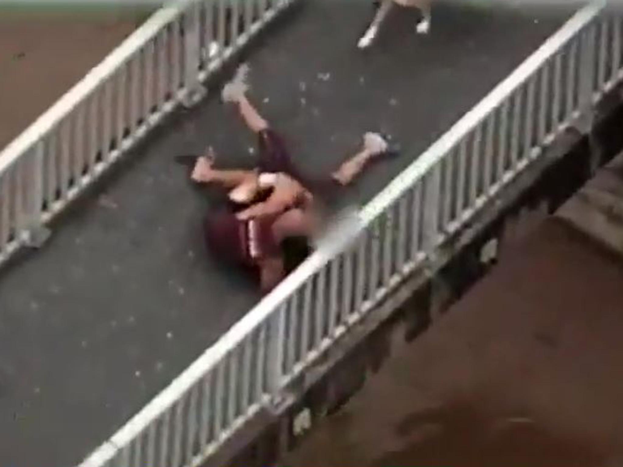 Dog walker wrestles fugitive to the ground then high-fives police