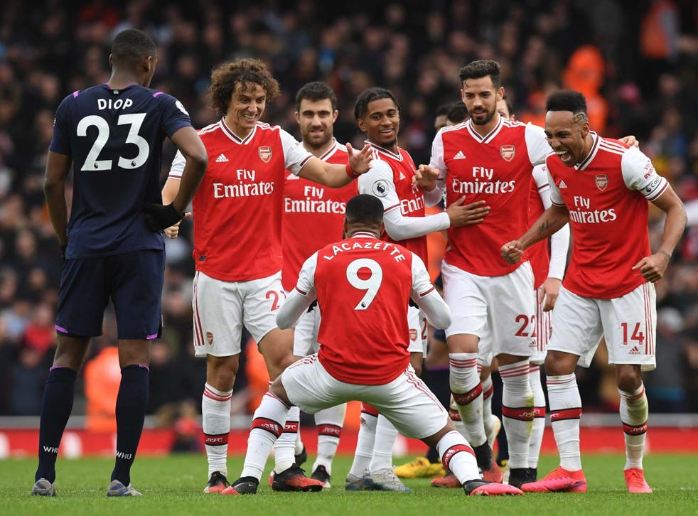 Alexandre Lacazette celebrates scoring the winner