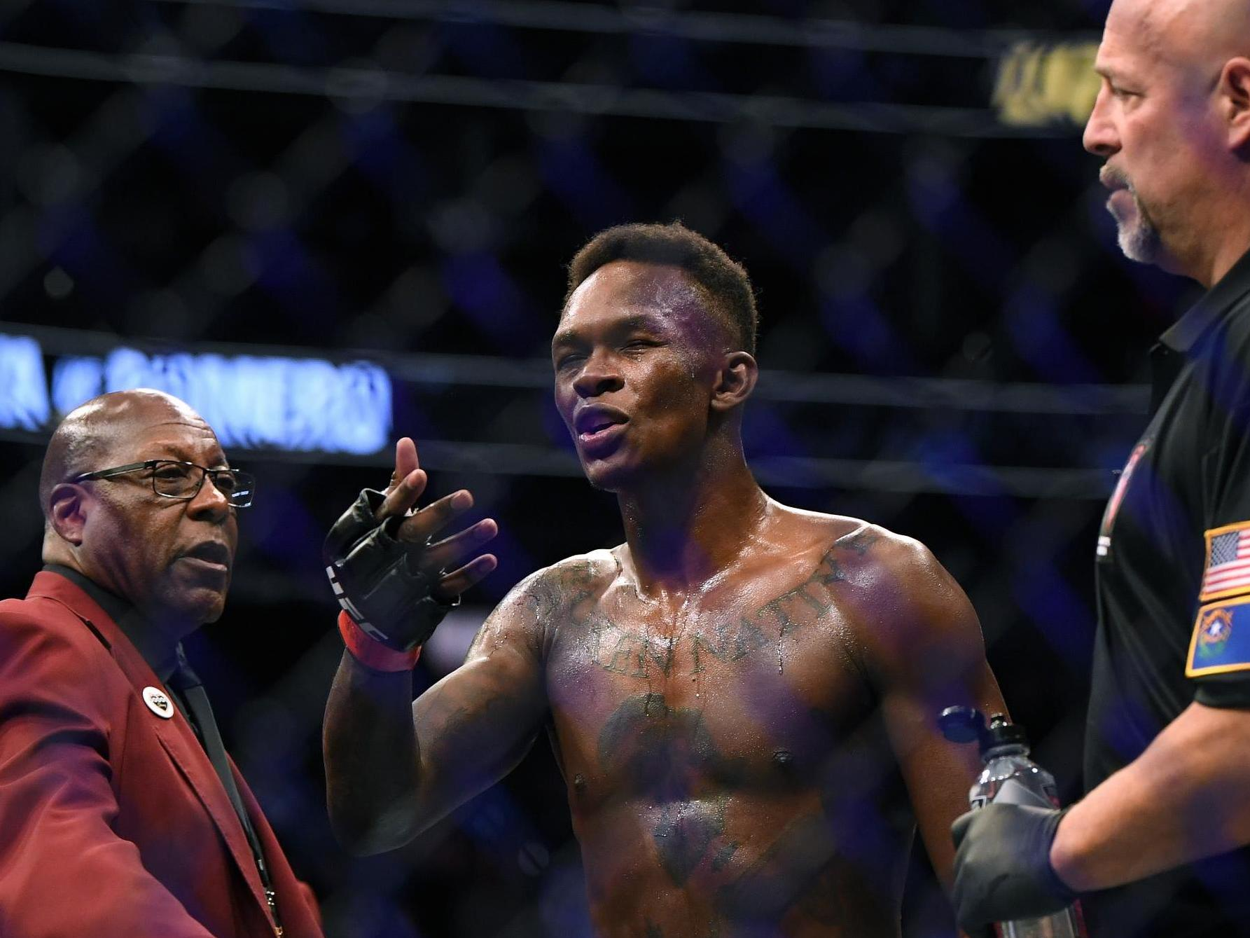 UFC champion Israel Adesanya speaks at protest in New Zealand