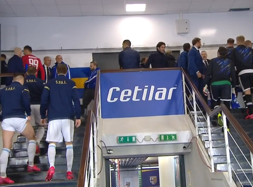 Parma and SPAL players are forced to wait in the tunnel while a decision over coronavirus is discussed
