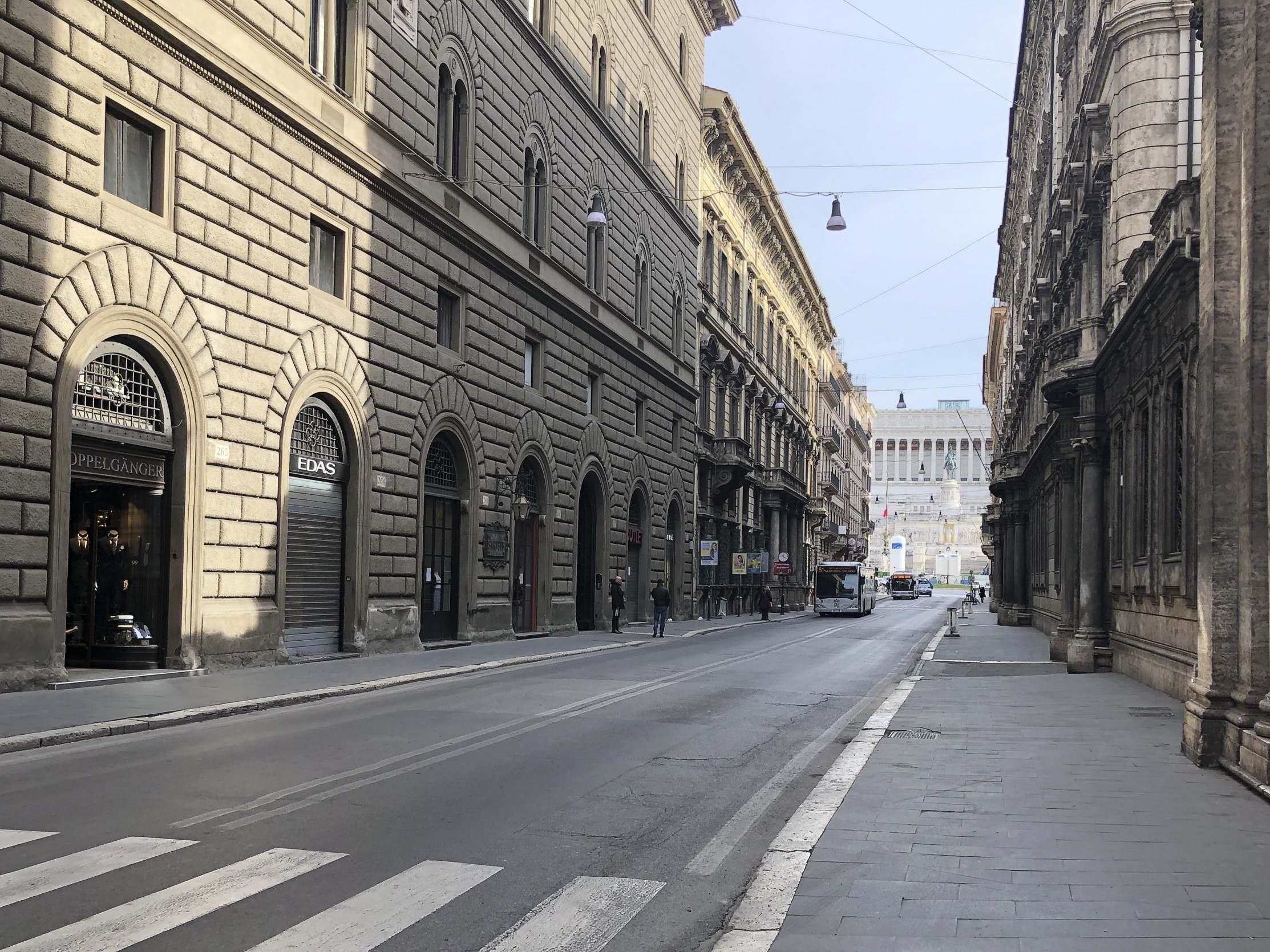Deserted Italian street rings out with song as people lean from windows to sing together during lockdown